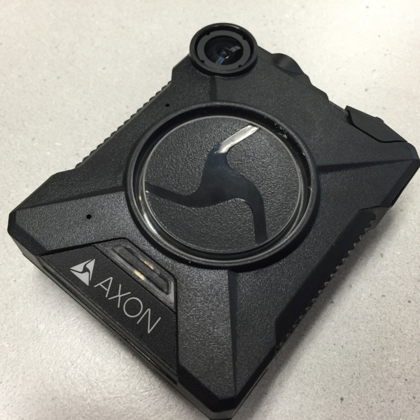Axon-brand body-worn camera laying on a table