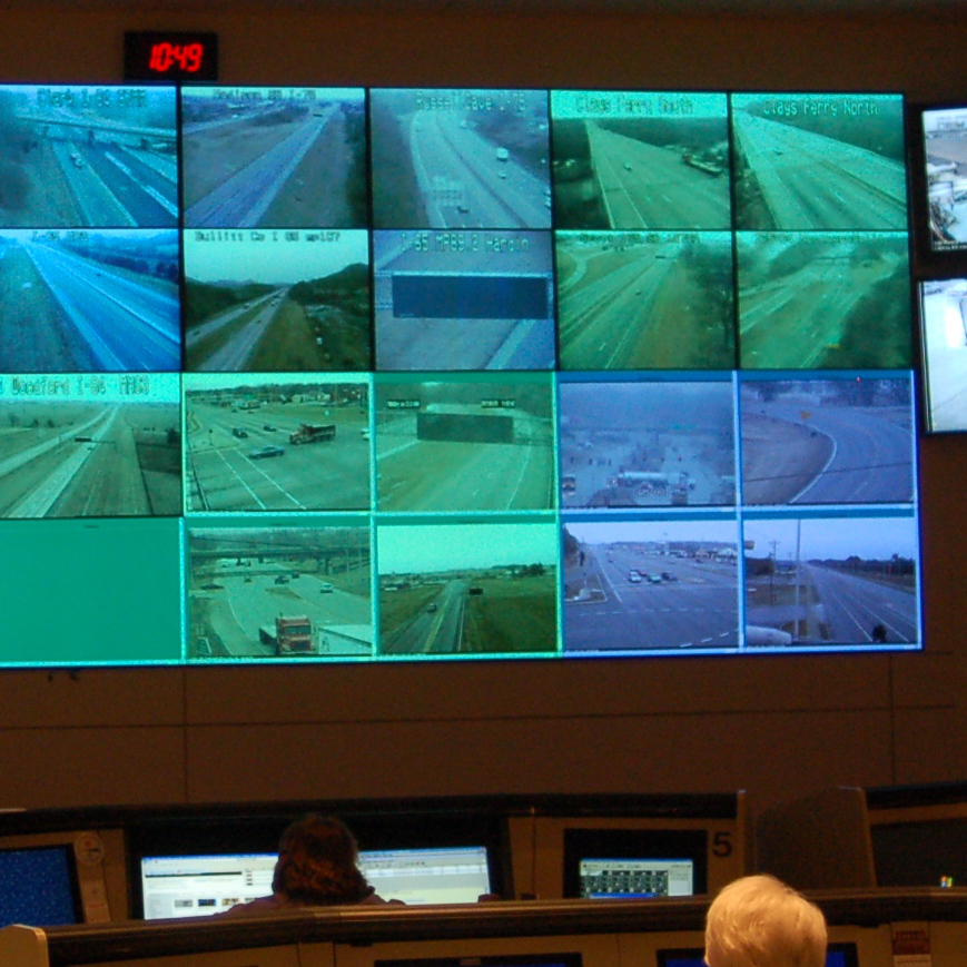 A wall of video monitors displaying live traffic feeds