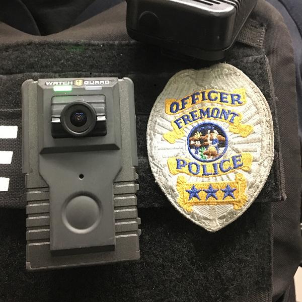 WatchGuard brand body worn camera affixed to an officer's uniform