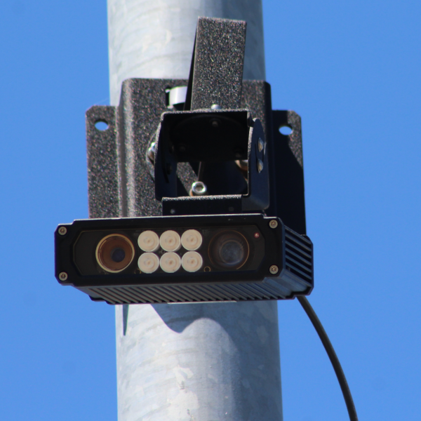Vigilant brand automatic license plate reader affixed to a light pole